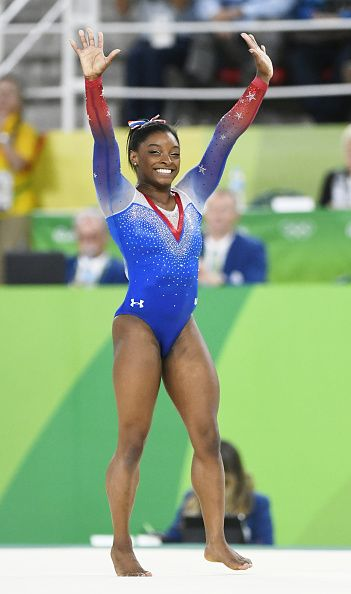 US gymnast Simone Biles waves at the crowd after performing in the women's floor…