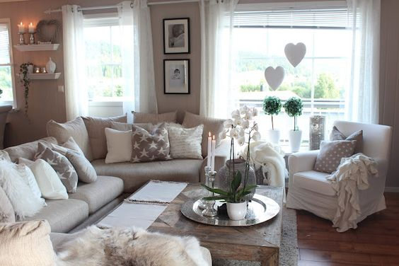 Beige livingroom. Love the gray and white pillow accents and LOVE the coffee table: