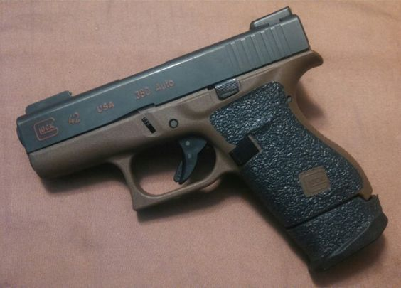 Glock 42 with rubber adhesive grip and a +2 Strike Industries mag extension. | My Guns ...
