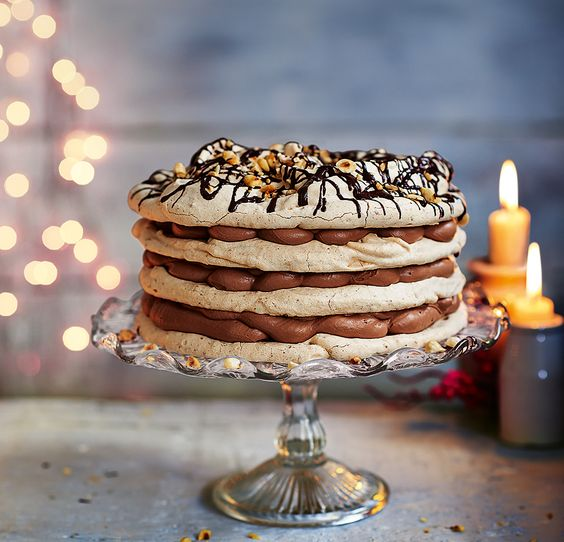 This showstopper cake recipe is made with layers of hazelnut meringue and sherry chocolate cream then topped with chocolate and toasted hazelnuts.