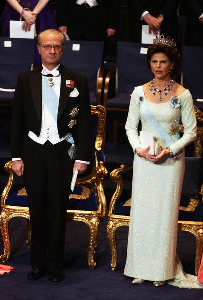 royaland:  majesty-in-its-prime:  One of the most beautiful dresses I have ever seen:  Queen Silvia's white dress at the 2004 Nobel Prizes  Very beautiful dress and jewels.