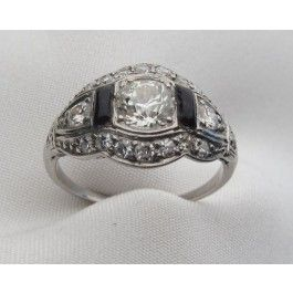 Shop Art Deco platinum engagement ring centered by a .63 carat Old European cut diamond with onyx and diamond accent stones at Isadoras Antique Jewelry. $8400