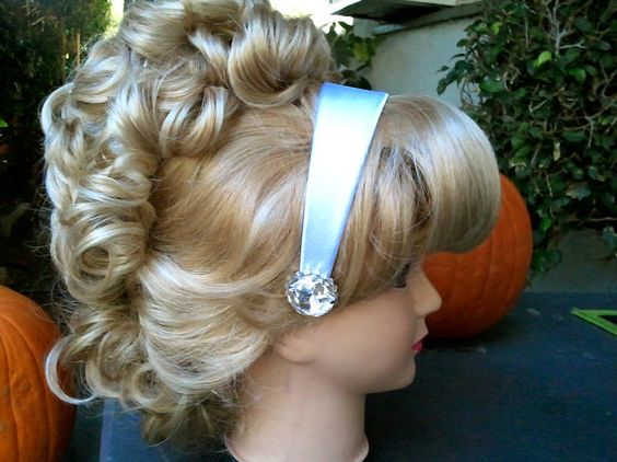 this is a headband made for childrens cinderella costumes, or if you are me, just for any day! its a silvery color with a blue hue that truly fits any color cinderella dress, from a darker blue, to a lighter baby blue. it has large jewels on each side and finished off with a ring of swarovski crystals!  The headband in the photo is actually the adult size. The childrens size is thinner with slightly smaller jewels. Childs size is seen in last photo. if you would like yours done with more…