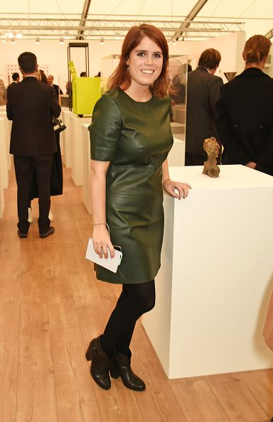 Princess Eugenie sports a green pleather shift dress from TopShop and black ankle boots as she arrives at the Frieze Art Fair in London's Regent's Park