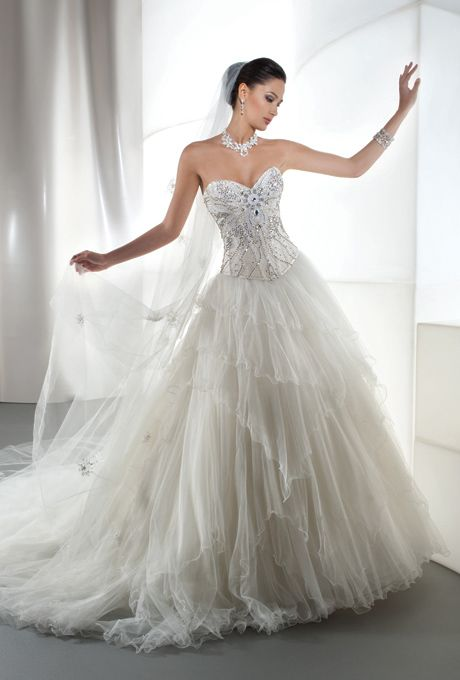 Brides: Demetrios - Young Sophisticates. Tulle ballgown with a jewel embellished corset bodice finished with a lace-up back. Skirt features multi-tiers of ruffled tulle and an attached train. Available in white, and ivory. (also available as separates).
