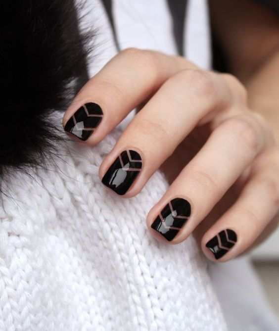 Black negative space nail design with striping tape