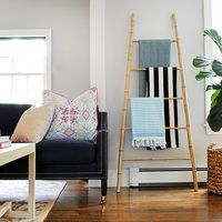 An easy-to-follow tutorial for building a bamboo ladder out of bamboo poles and sticks. Perfect for use in closets, bathrooms, living rooms, and more.