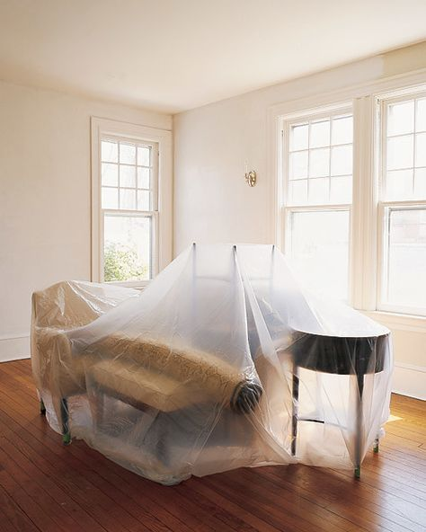 Remove small objects from the room; gather large ones in the center and cover with a plastic drop cloth. Unscrew switch and outlet face plates. Lay masking paper over floors and tape as shown below. Protect carpeting with canvas drop cloths.