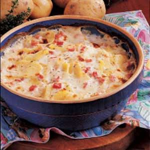 Scalloped Potatoes with Ham, did not use the thyme, added 1 cup of cheddar during the last half hour with the extra butter.