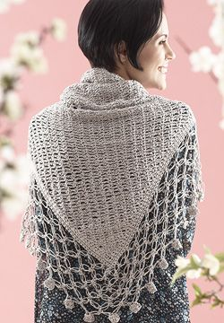 Crocheted from tip up, this shawl will keep you cool in the summer and cozy in the winter. Shown in Patons Grace.