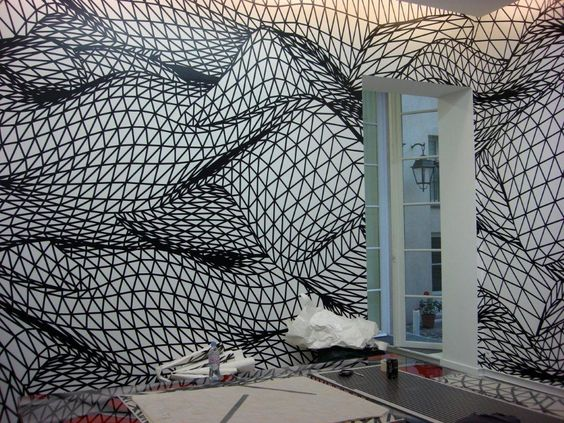 Can't believe how awesome some people are! 23M2 of window space in an art gallery was been decorated with an interesting and complex visual. The design was completely hand cut by the artist on black coloured film.