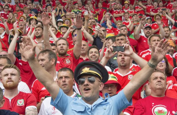 """A French newspaper has sung the praises of Welsh football fans, who have celebrated Euro 2016 peacefully, while England and Russian supporters have been embroiled in violent clashes. 