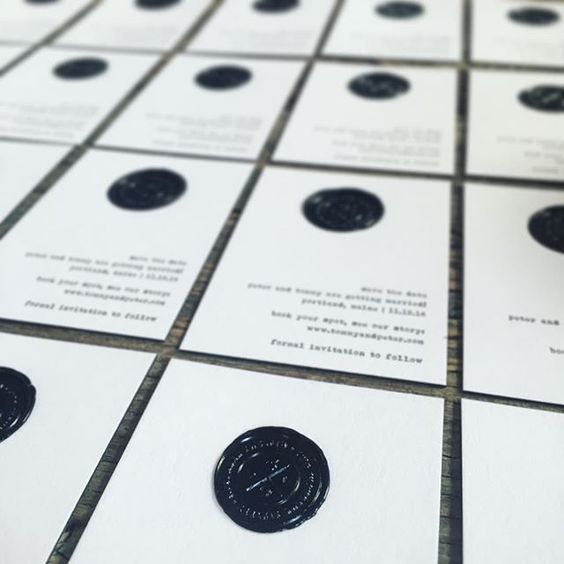 All black wax seals filled with details like the little peach and apple icons! #fourteenforty #1440nyc #waxseal