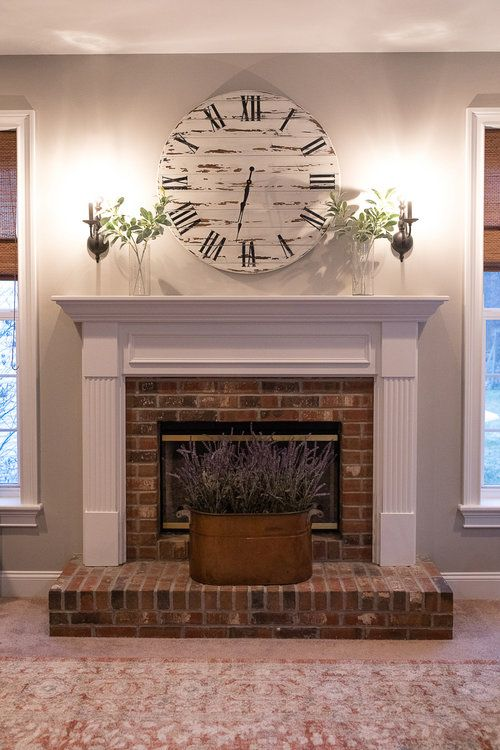 Large Wall Clock Painted White And Distressed It Is The Centerpiece Of This Living Room And Placed Pe Large Wall Clock Fireplace Farmhouse Style Furniture