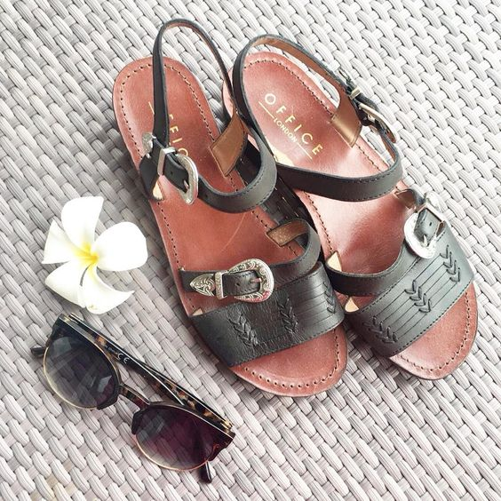 It's all in the details this summer ☀️🌸 Feat our Buck Western Sandals in black leather. #Shop from our bio. #summerready #holiday #fwis #flatlay