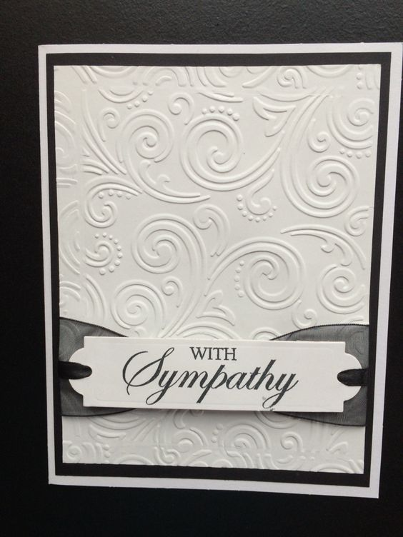 """Sympathy card using Spellbinders Back to Basics Tags die and """"With Sympathy""""clear stamp. 5x6.5"""" pre-made white card was layered with black card stock and white card stock embossed with Paper Studio - Intricate Swirl embossing folder. Sheer black ribbon and small black satin ribbon were used behind the label and tucked under the white card stock layer. Created by: Melanie Weise"""