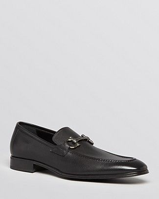 Topped with Salvatore Ferragamo's signature metal Gancini logo, these classic slip-on loafers are a smooth and versatile addition to the well-appointed wardrobe. | Leather/rubber | Made in Italy | Fit