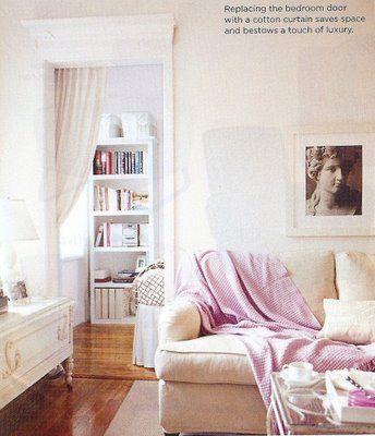 Domino Magazine, 200 sq. ft of style, Manhattan apartment, studio apartment.  Purple throw blanket.  English roll arm sofa.  White bookcase.
