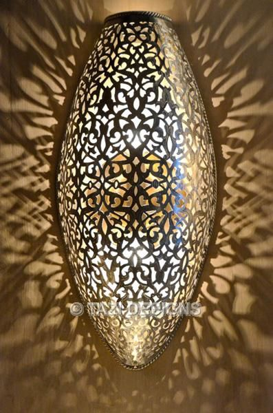 Pierced Moroccan sconce wall light, casting beautiful shadows by Tazi Moroccan Design. # ...
