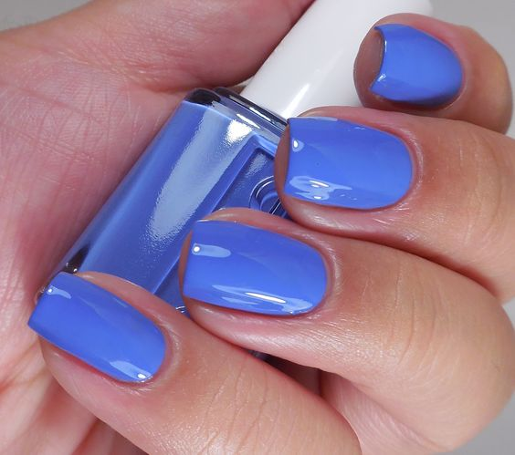 Bring on the waves with this pristine blue 'pret-a-surfer' nail polish.