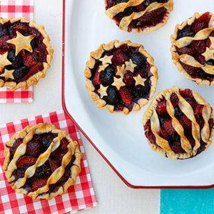 Individual fruit pies are the perfect end to a Fourth of July meal, using bright red cherries, raspberries, and strawberries, of course.
