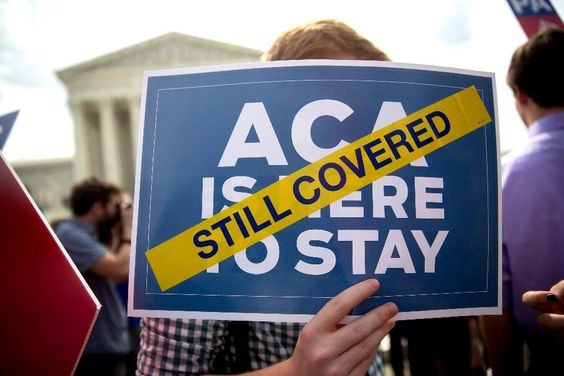 A 51-percent premium hike rescues obamacare in Pinal County -  Demonstrator Ryan Thomas, a supporter of U.S. President Barack Obama's health-care law, the Affordable Care Act (ACA), holds an