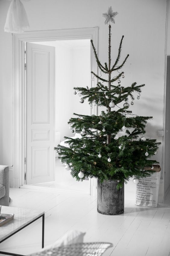 A Nordic Christmas Tree With Silver And White Ornaments In A Galvanized Scandinavian Christmas Trees Scandinavian Christmas Scandinavian Christmas Decorations