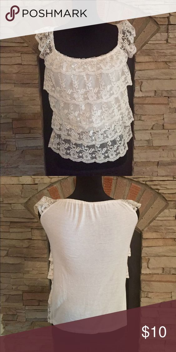 Ivory Lace Layered Top Pretty lace layered top, with stretchy and soft material underneath and in back. Bottom layer of lace is shear. Has a bit of wear under the arms from wearing with cardigans. Not very noticeable at all.  No trades Rue 21 Tops Blouses