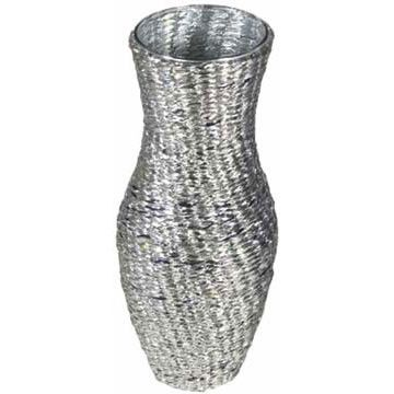 Reclaimed foil intricately wrapped around a glass vase, from Hipcycle.