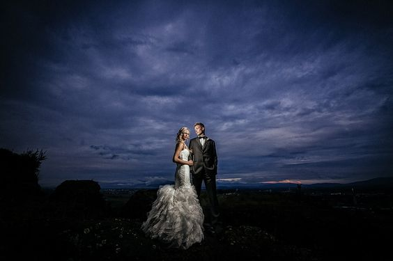 Matt Shumate Photography at Arbor Crest Winery dramatic wedding bride and groom portrait with dark stormy skies and a wide angle lens looks like dvd cover movie cinematic