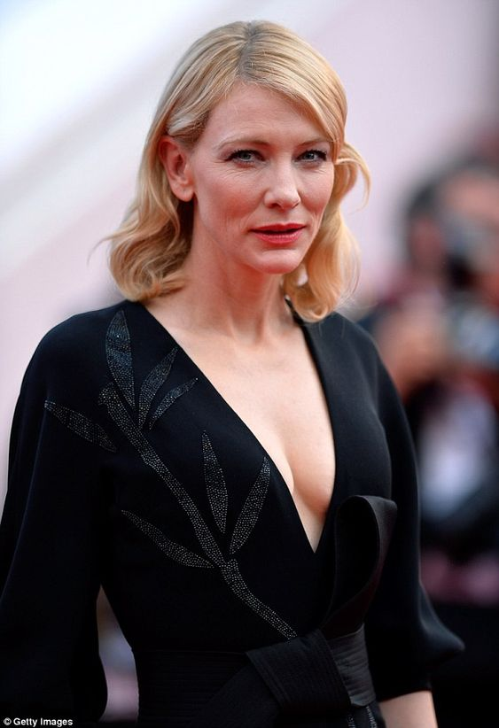 Cate Blanchett shows some cleavage in her low-cut black gown at Cannes #dailymail