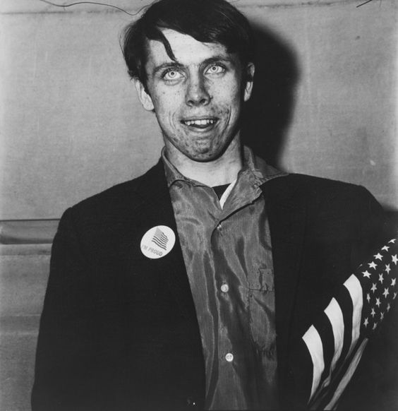 Diane Arbus, Patriotic Young Man with a Flag, N.Y.C. @artsy