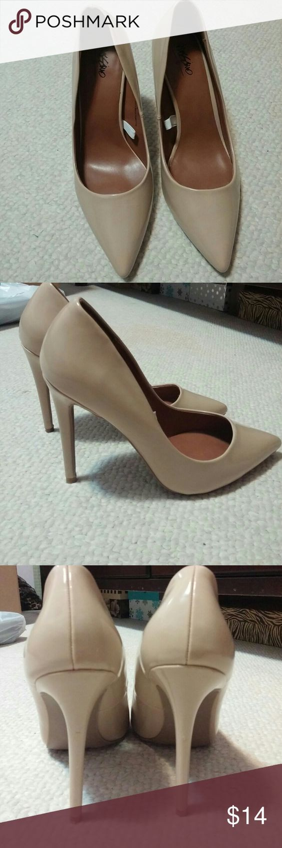 Mossimo Nude Pumps Nude pumps. 4 inch heel. Only worn once for a wedding. Sorry no trades. Mossimo Supply Co Shoes Heels