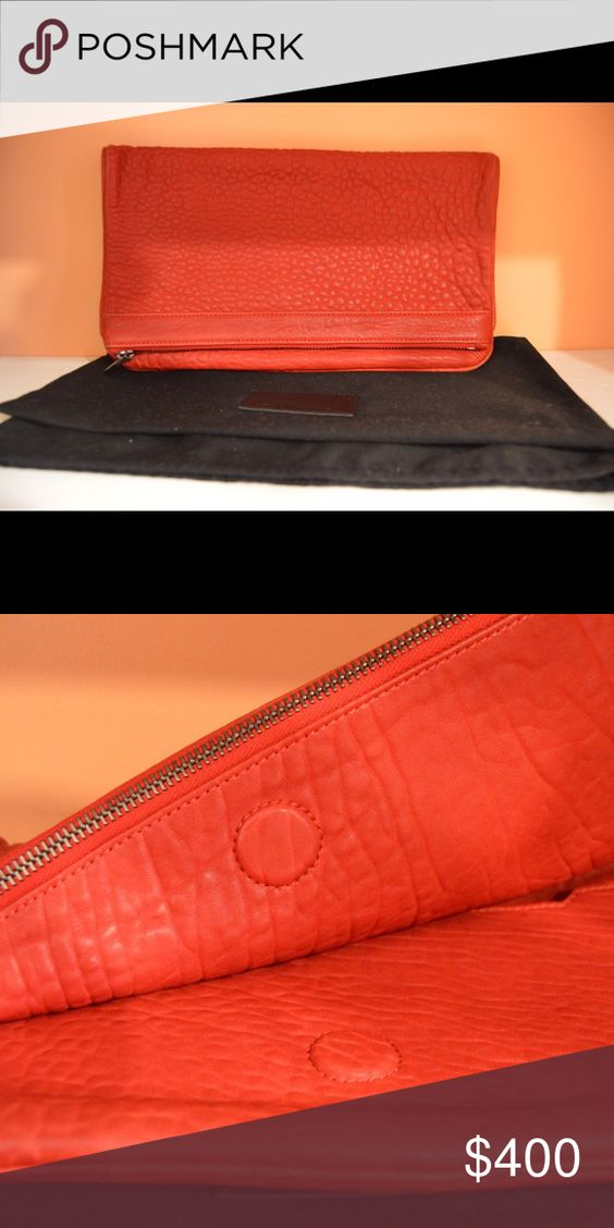 Alexander wang leather zip fold over clutch bag Oversized clutch to carry essentials for a night out. Back zip compartment. Front slit compartment with zip pocket. Top panel fold over with top zip closure; hidden magnetic closure. Comes with dust bag. Alexander Wang Bags Clutches & Wristlets