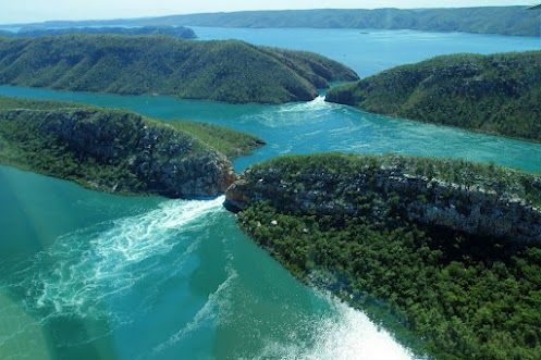 The magnificent Horizontal Waterfalls in Western Australia are created by massive tidal movements, among the biggest in the world. The white water ocean banking up against one side of a narrow cliff passage creates the waterfall effect.