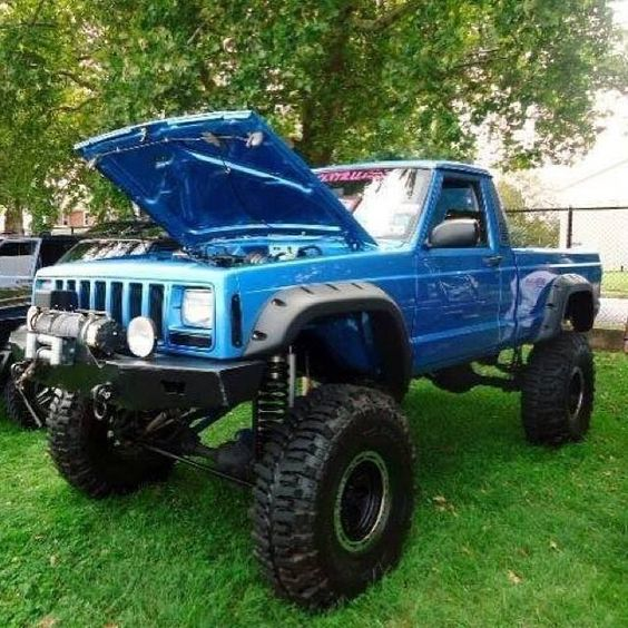 Lifted Blue Jeep Truck MJ With Baja Lights And Winch