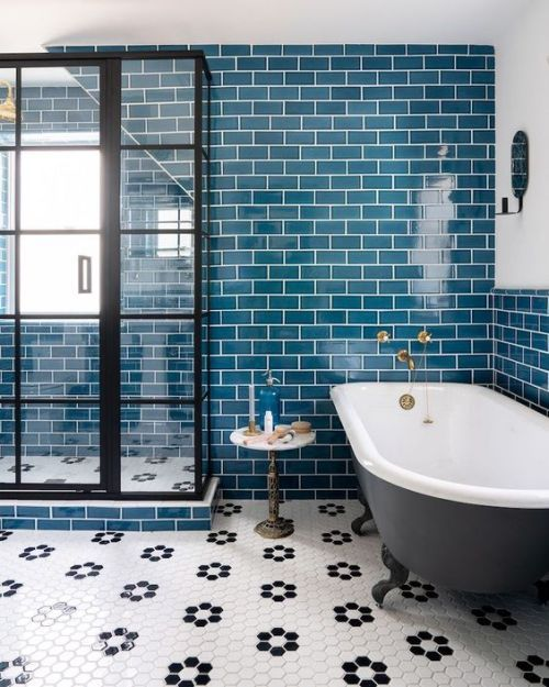 Bathroom With Bright Teal Tiles On The Wall Accented With White Grout And A Hex Tile Floor Colorful Bathroom Tile Bathroom Style Tile Bathroom