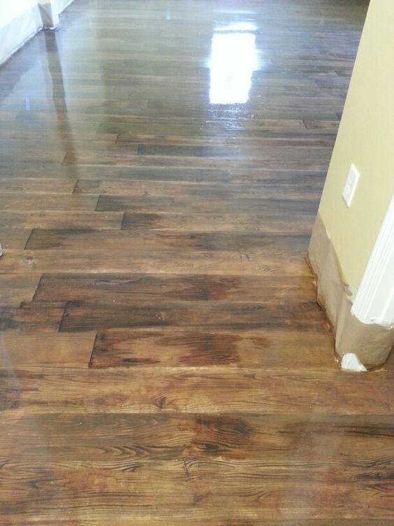 concrete floors stained to look , like wood...