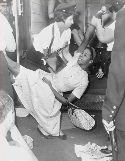An African-American Woman Being Carried by the Police During a Civil Rights Protest:  A Proud Heritage: Photos From the Civil Rights Movement