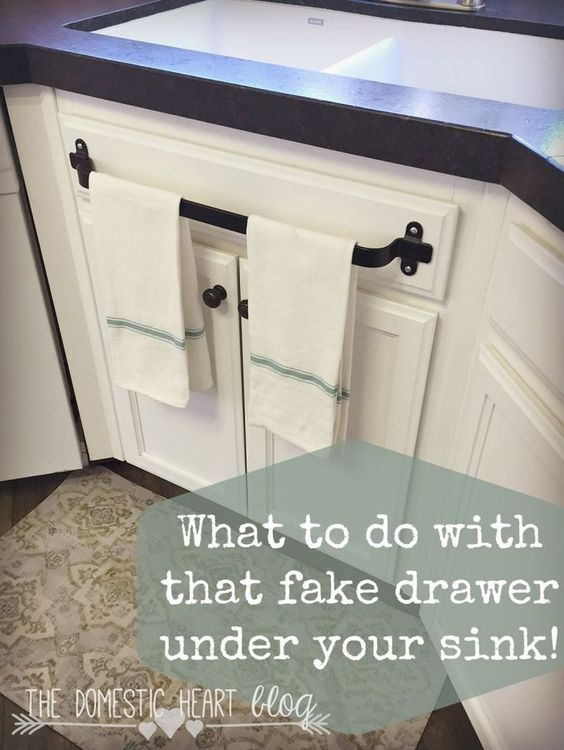 What to do with that fake drawer under your kitchen sink for Under sink cabinet tray