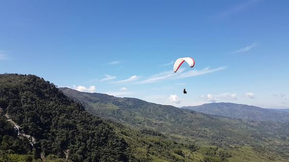 Paragliding over giant waterfalls - Image 9