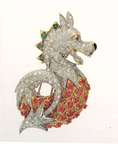 """Donald Claflin Dragon Brooch for Tiffany's - Claflin also designed a series of """"friendly"""" dragons - one of them with popping ruby eyes that telescoped out, all encrusted with diamonds, sapphires, rubies and emeralds, or executed in brilliant enamels."""