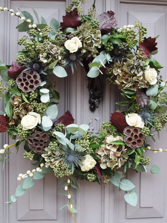 Hanging door wreath at the entrance of the reception venue? Withe red grandprix roses, berries, whites,berries, golds etc..