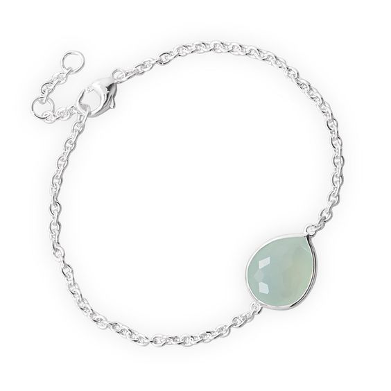 "7"" + .5"" + .5"" Freeform Faceted Synthetic Sea Green Chalcedony Bracelet. 7"" + .5"" + .5"" extension rhodium plated sterling silver bracelet with freeform faceted pear shape synthetic sea green chalcedony center. The faceted synthetic chalcedony is approximately 13mm x 14.5mm. The bracelet has a lobster clasp closure. The beautiful freeform facet cut gives stones extra brilliance, with lots of artistically irregular cuts along the top of the stones. Made with .925 Sterling Silver. *** This item…"
