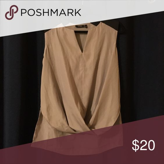 Silky dress top Taupe silky dress shirt with black cap sleeves. Gathered detail in the front of the shirt. Has a slight high low style Tops Blouses