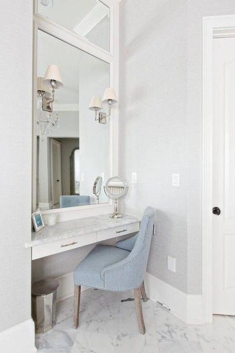An Elegant Makeup Nook With A Powder Blue Velvet Chair An Oversized Mirror And Several Lam Bathroom With Makeup Vanity Diy Makeup Vanity Bathroom Vanity Chair