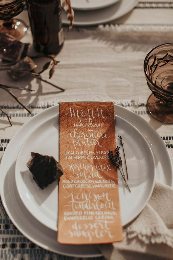 Leather menus from this glamping wedding inspiration at Panacea at the Canyon | Image by Lieben Photography