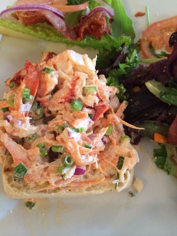 Lobster salad with carrot, scallions and red onion.