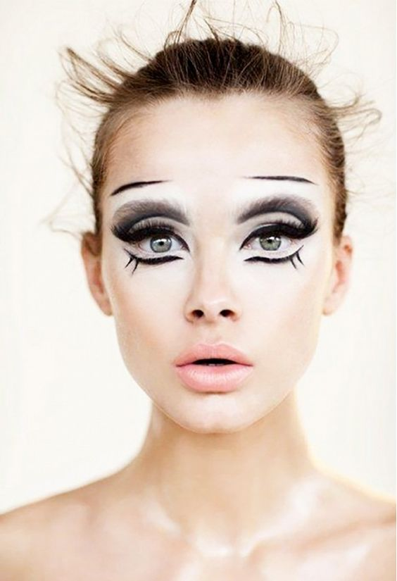 Animalistic, doll-like face paint with different layers and textures. // Halloween makeup ideas