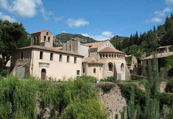 Saint-Guilhem-le-Desert, Herault. Located in the heart of the Val Gellone, Saint-Guilhem-le-Desert is a most picturesque village. Walking the old streets, lovers can admire the houses nestled together and let it tell the legends surrounding the history of the château du Géant and l'abbaye de Gellone.
